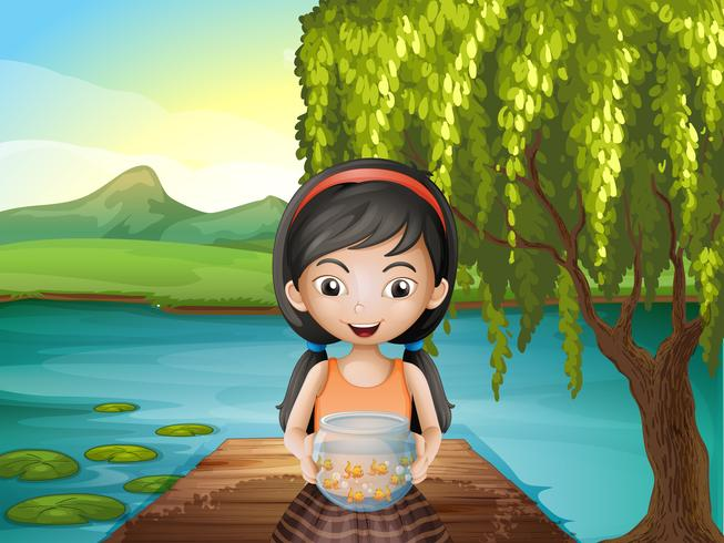 A girl with an aquarium standing at the riverbank