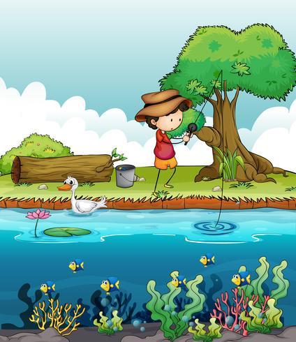 Um menino pesca