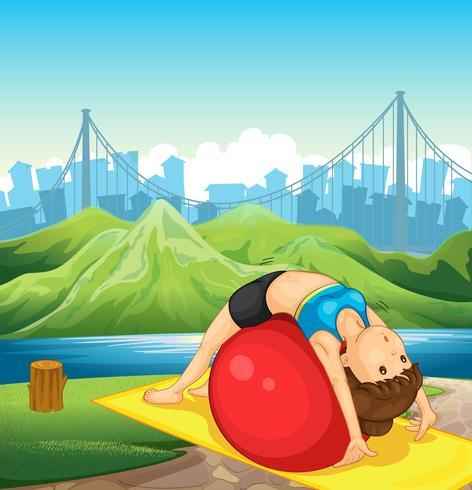 Una joven haciendo ejercicio cerca del río.
