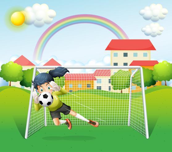 Una donna sportiva che gioca a calcio