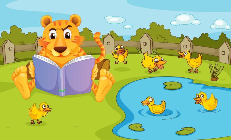 Un tigre leyendo junto a un estanque con patitos.