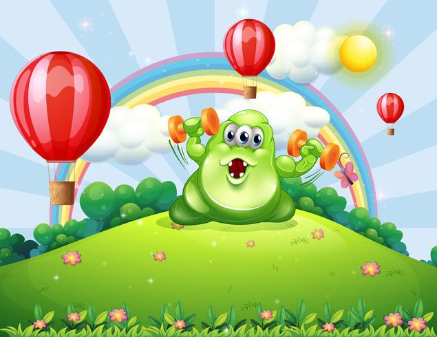 Un mostro verde che si esercita in cima alla collina con palloncini galleggianti