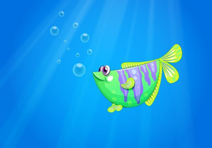 Un pesce verde sotto il mare