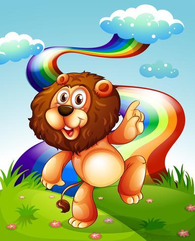 Un león juguetón en la cima de la colina y el arco iris en el cielo.