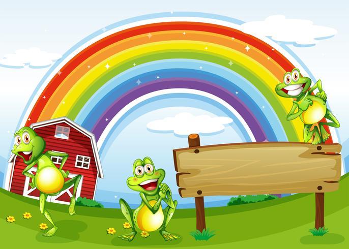 Una tavola di legno vuota con le rane e un arcobaleno nel cielo