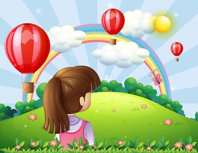 Una joven mirando los globos flotantes y el arco iris.