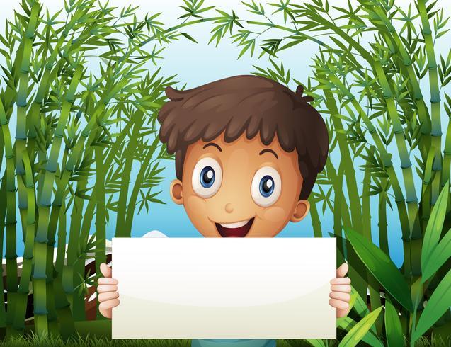 En pojke på bambu gården med en tom skyltning