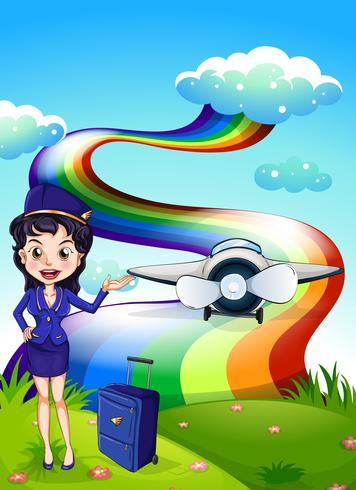 Een vrouwelijke piloot op de heuveltop met een vliegtuig en een regenboog