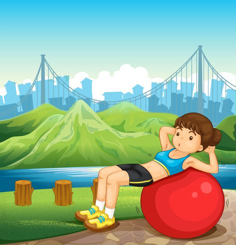 Ein Mädchen, das nahe dem Fluss über den hohen Gebäuden trainiert