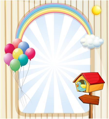 Ein Pethouse in der Nähe einer leeren Vorlage mit Luftballons und Regenbogen