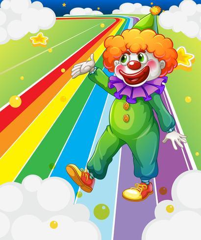 Un clown in piedi nella strada colorata