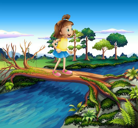 Una niña pequeña cruzando el río.