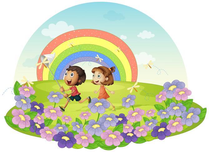 Enfants dans un champ chassant les insectes