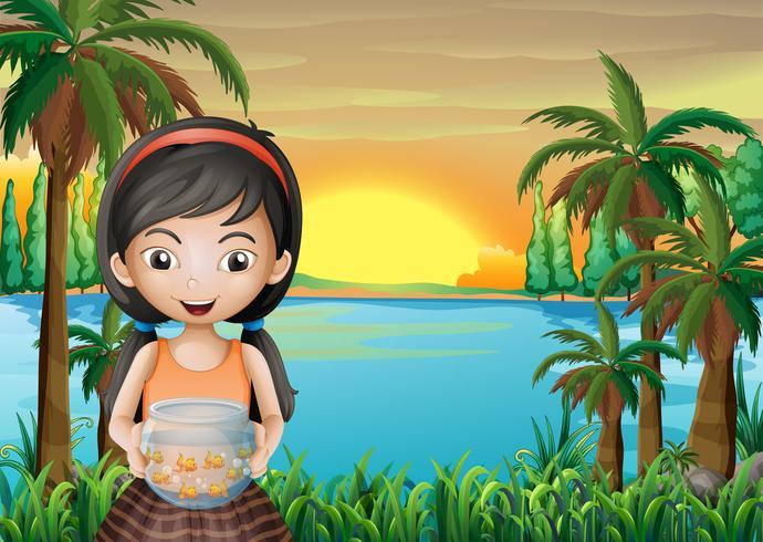 Een jong meisje met een aquarium