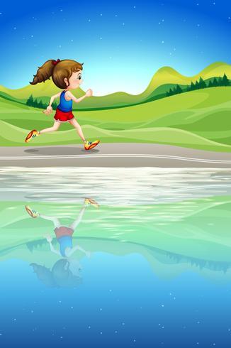 Een meisje dat langs de rivier loopt