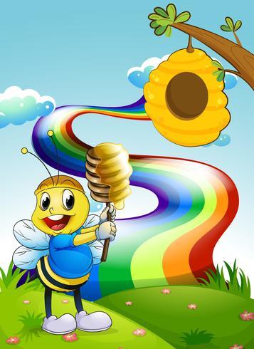 Une abeille au sommet d'une colline avec un arc-en-ciel dans le ciel