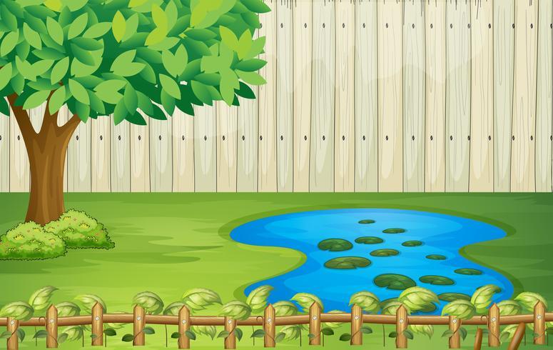 Ett träd, en damm och ett vackert landskap