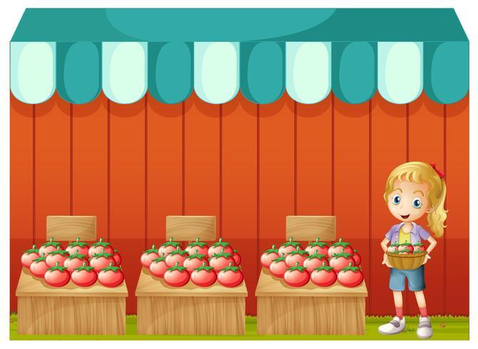 Una niña vendiendo tomates
