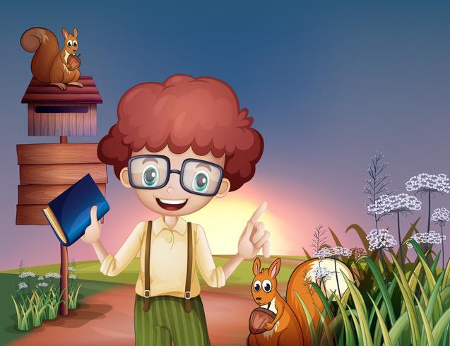 Een jongen met een boek op de heuvel met twee eekhoorns