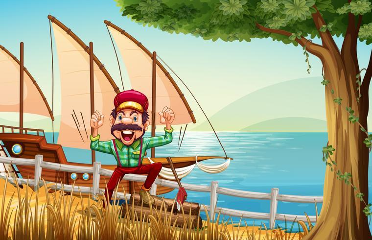 Un leñador cerca de la valla en la orilla del río con un barco