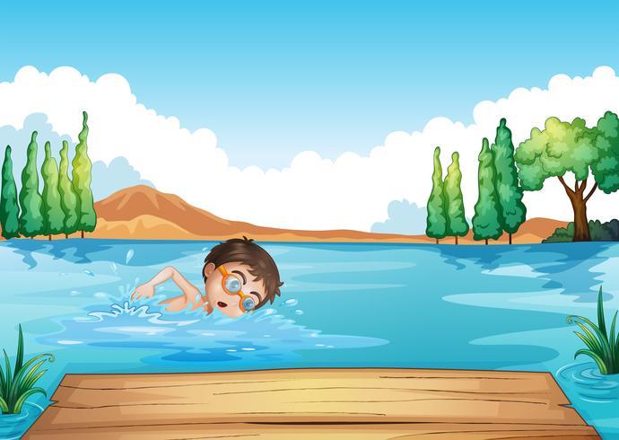 Un nadador masculino ensayando cerca del trampolín.
