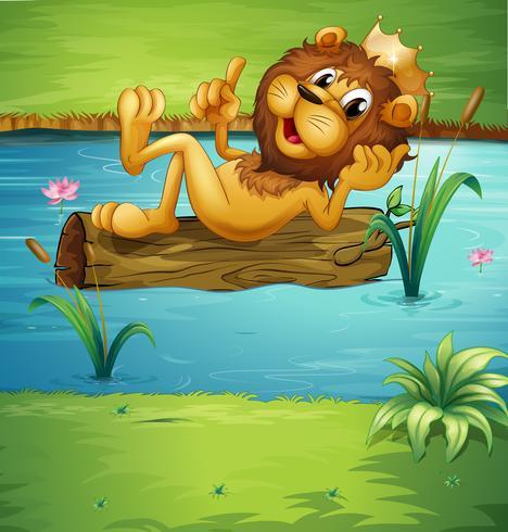 Un león sonriente sobre una madera seca.