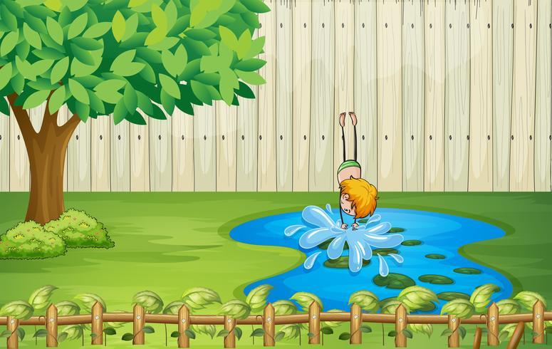 Ein Junge taucht im Teich
