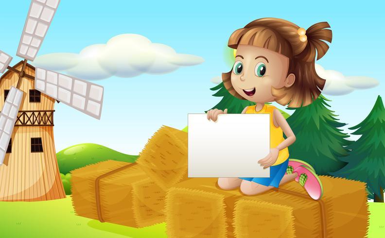 Una niña encima de los hays sosteniendo una señalización vacía.