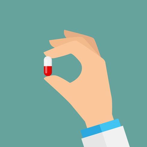 Mano sosteniendo una pastilla