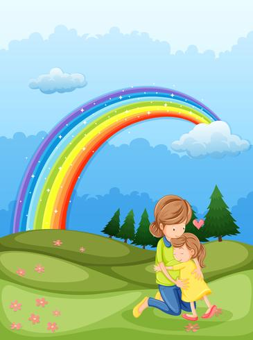 A mother and a child hugging near the rainbow
