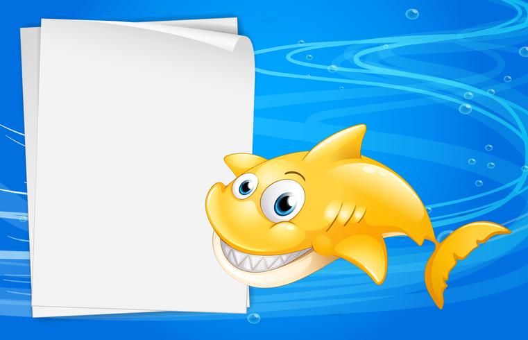 Un pez amarillo al lado de un papel vacío. vector