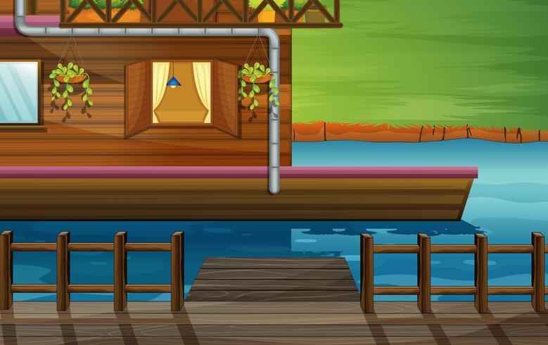 Een houten huis in de rivier
