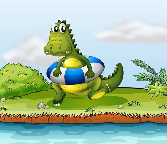 Un crocodile au bord de la rivière avec une bouée