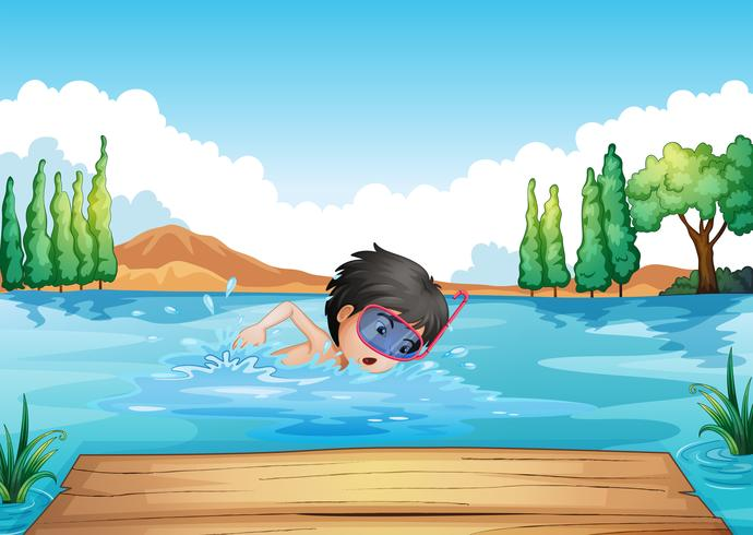 En pojke som simmar i floden med en rosa goggle