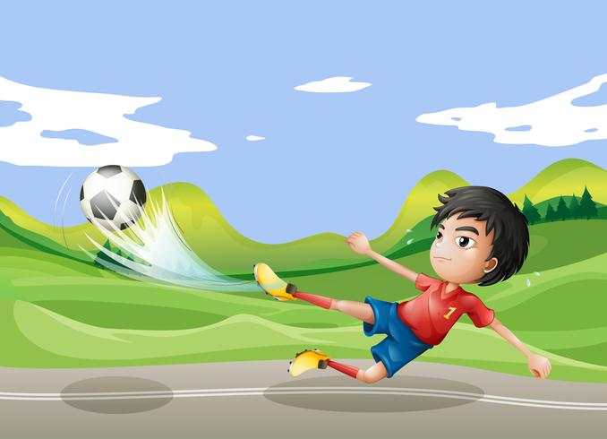 Ein Spieler, der Fußball an der Straße spielt