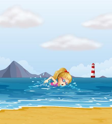 Una niña nadando en el mar con un faro en la espalda.