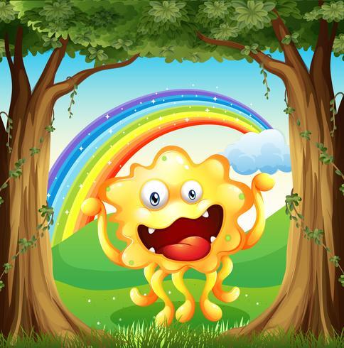 Een monster in het bos met een regenboog in de lucht
