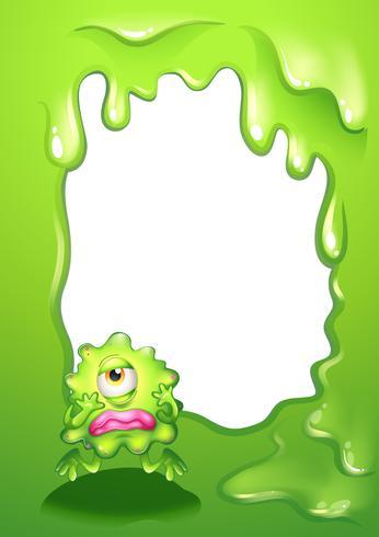 Ett grönt monster i grön gränsdesign