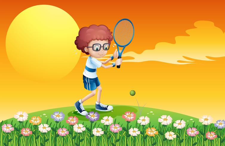 A boy playing tennis at the hill