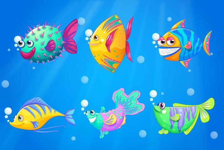 Un océano con un grupo de coloridos peces. vector