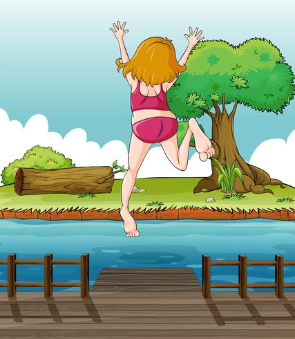 Une fille sautant sur le pont en bois