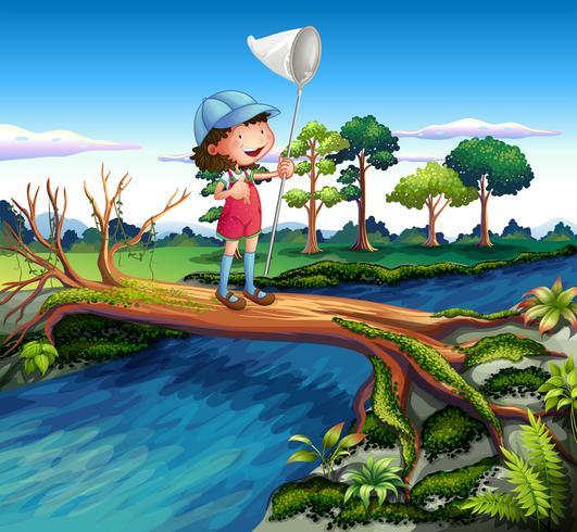 Una niña sosteniendo una red de mariposas cruzando el río.