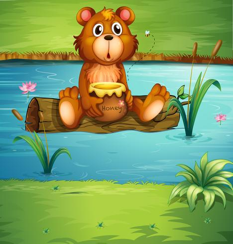 Un oso sentado en una madera seca.