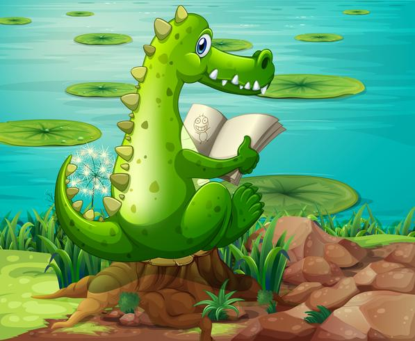 Un cocodrilo leyendo cerca del estanque.