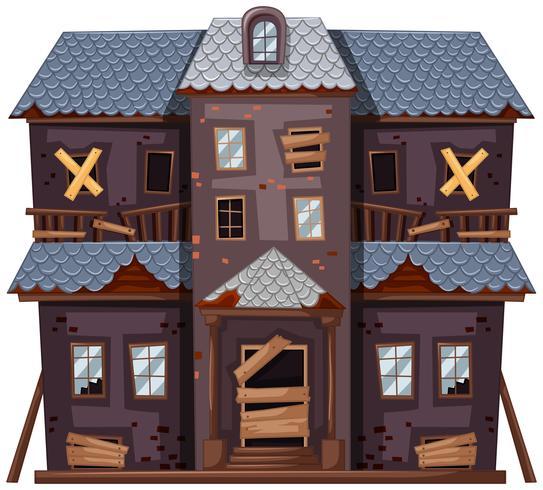 Gammalt hus med grå färg