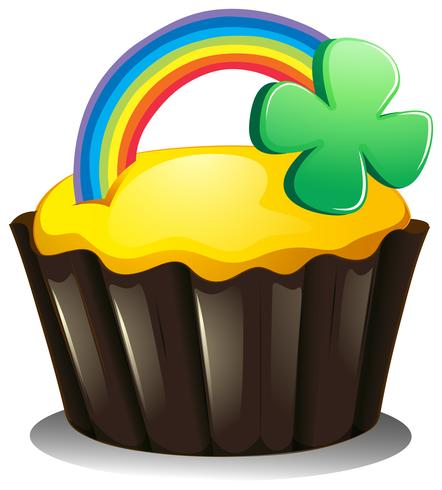 A cupcake with a rainbow and a plant vector