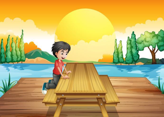 Uma mesa com bancada perto do rio