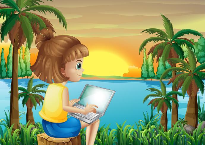Una niña usando su laptop cerca del río.