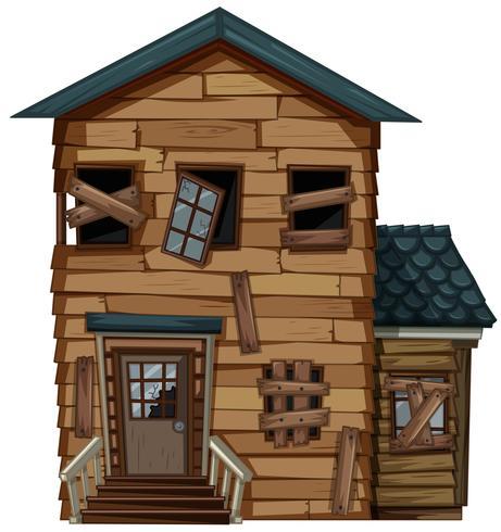 Vecchia casa con porta e finestre rotte