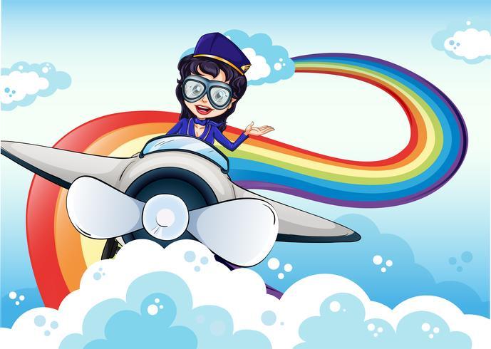 Una piloto mujer conduciendo el avión y un arco iris en el cielo.